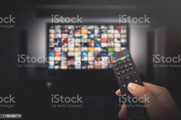 Photo of Multimedia video concept on TV set in dark room