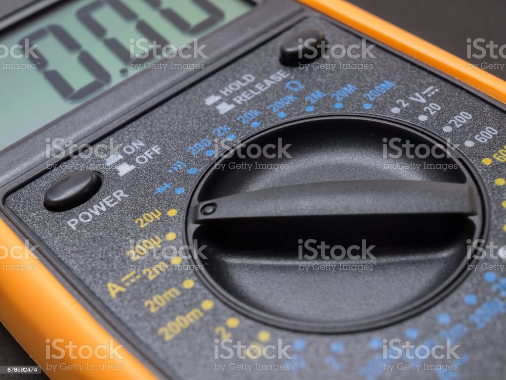 Multimeter and tester closeup on black background stock photo