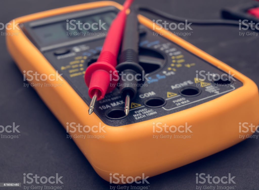 Multimeter and tester on black background stock photo