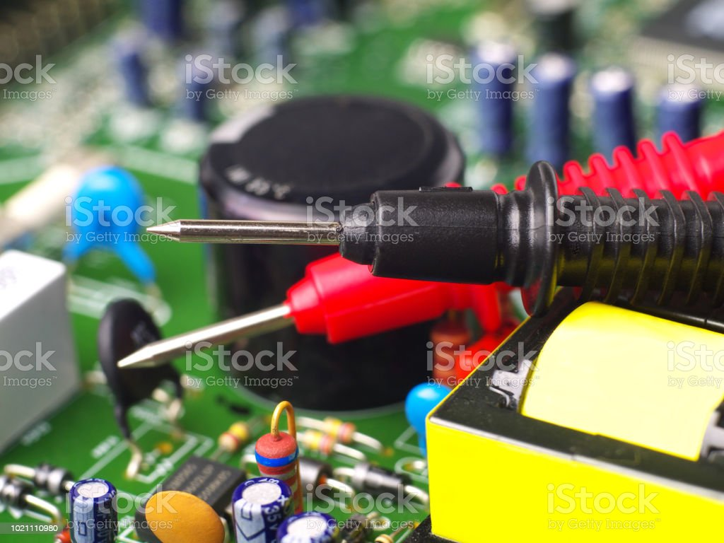 Multimeter Test Leads On Printed Circuit Board Closeup Shallow Depth Of Field Royalty