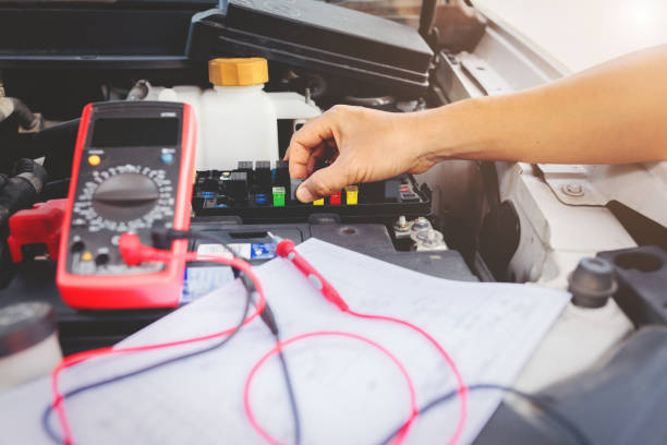 Multimeter to check the fuse in a car. stock photo