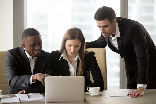 istock Multinational business colleagues working together 843533950