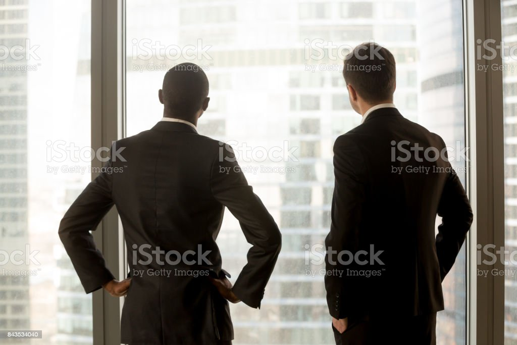 Multinational businessmen dreaming of success stock photo