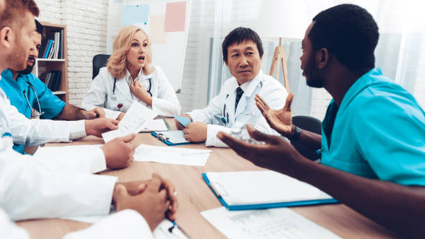 Multinational Doctors Group Diagnostic Meeting. stock photo