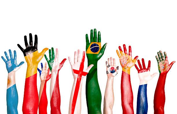 multi-national flags drawn on raised hands - football portugal flag bildbanksfoton och bilder