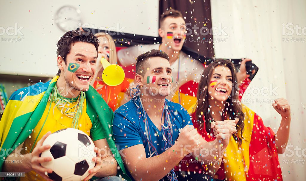 Multinational football supporters celebrating goal royalty-free stock photo