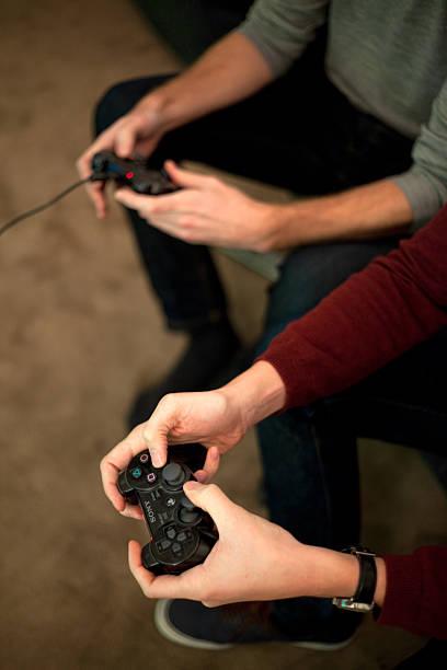 multiplayer gaming - playstation stockfoto's en -beelden