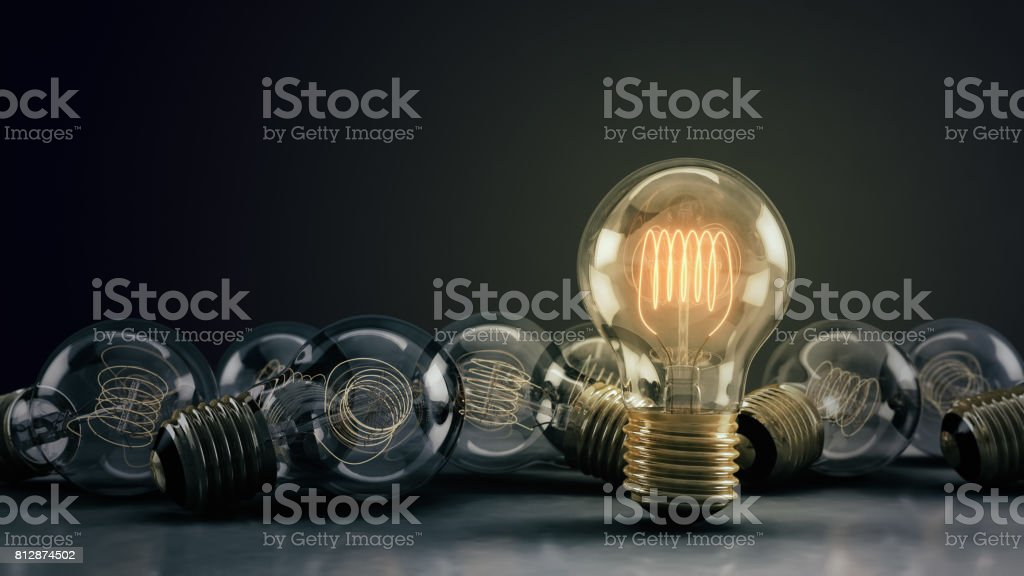 Multiple 3D Illustrated Incandescent Light Bulbs on a Reflective Surface stock photo
