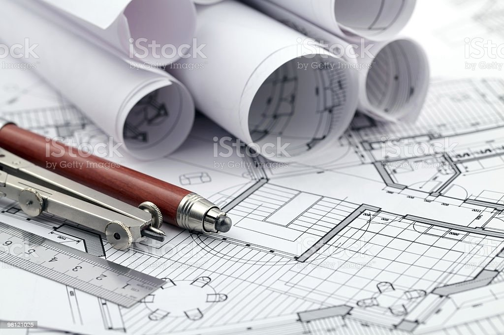 Multiple blueprints with a compass and pen royalty-free stock photo