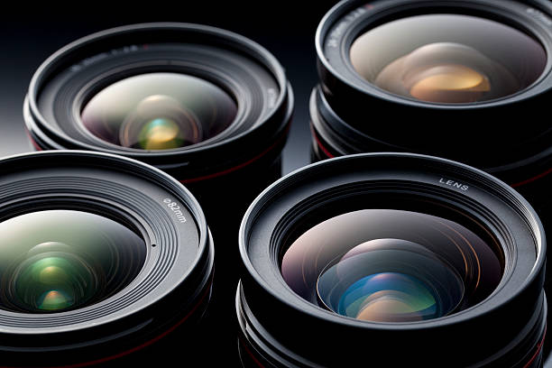 Multiple camera lenses, reflective lenses stock photo