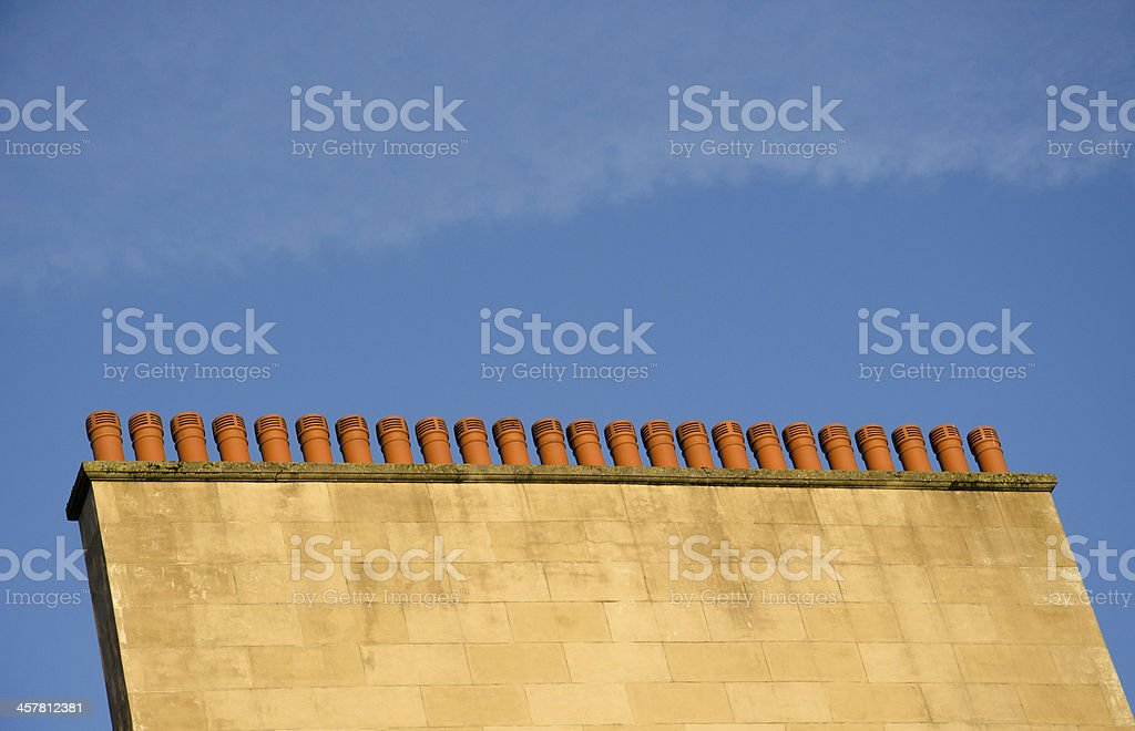 Multiple chimneys with blue sky in the background royalty-free stock photo