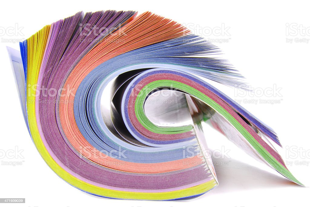 Multiple colored catalog rolled up stock photo