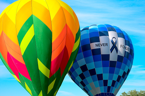 A colorful hotair balloon floats on the early morning breeze at the 2021 Albuquerque NM Balloon Fiesta.