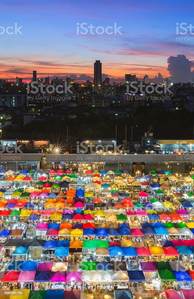 Multiple colours nights market with city background Lizenzfreies stock-foto