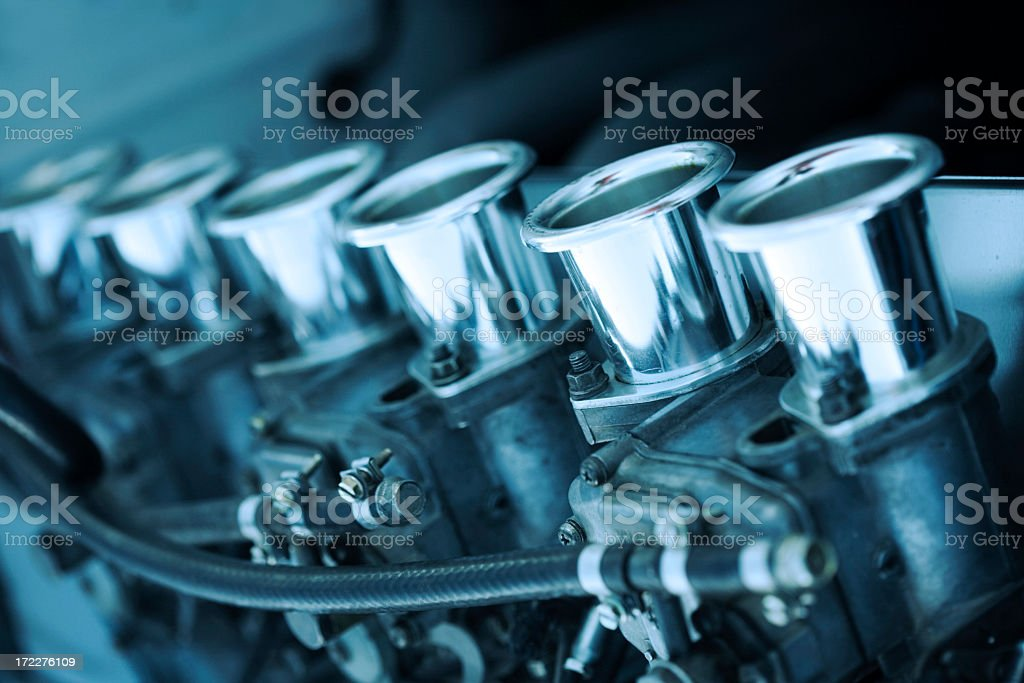 Multiple cylinder shaped object apart of a car engine royalty-free stock photo