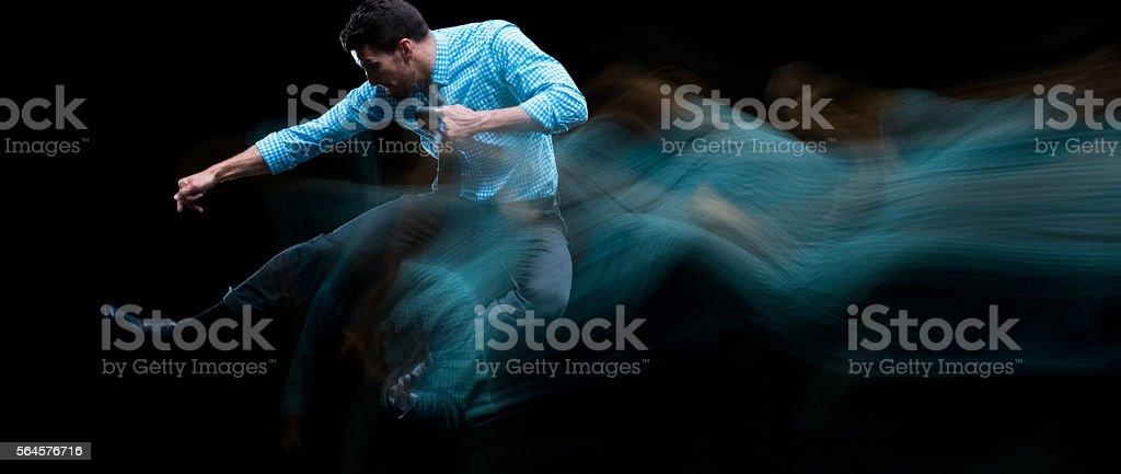Multiple Exposure - Businessman kicking stock photo
