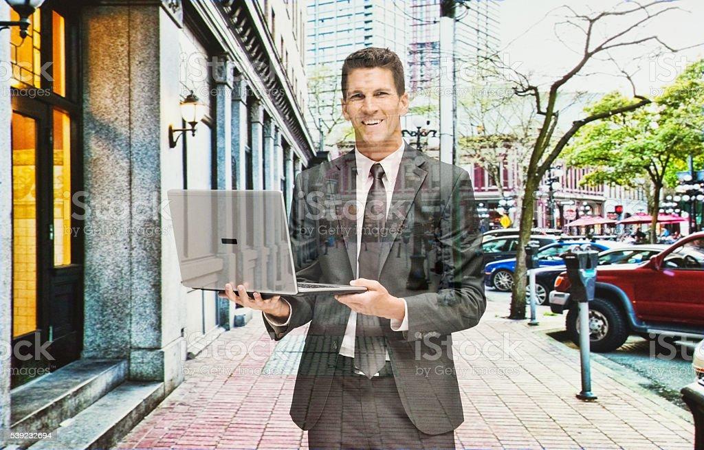Multiple Exposure - Businessman working on laptop royalty-free stock photo