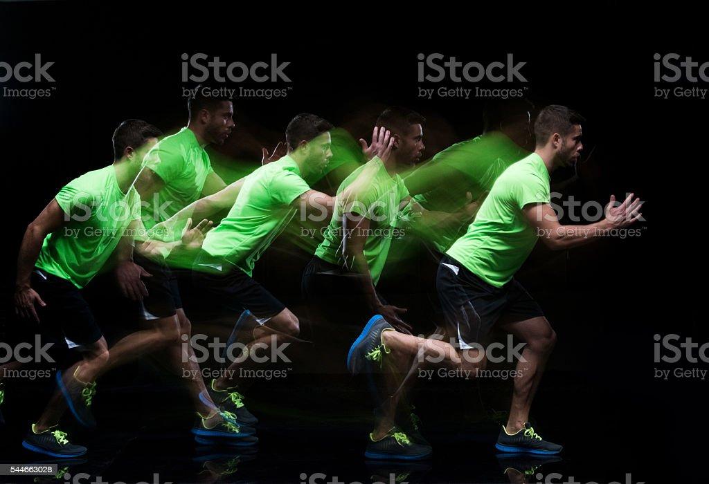 Multiple Exposure - Male runner running stock photo