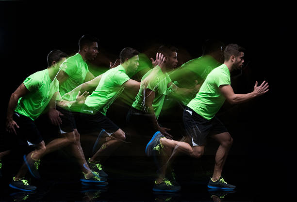 multiple exposure - male runner running - long exposure stock pictures, royalty-free photos & images