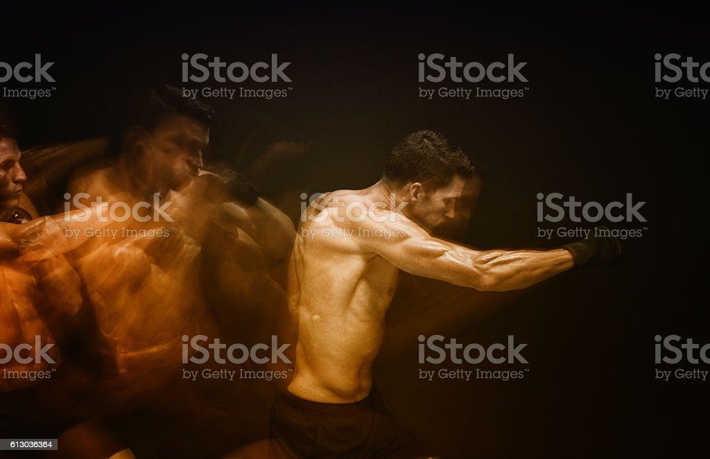 Multiple Exposure - Muscular man fighting stock photo