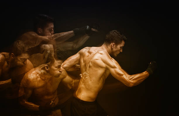 Multiple Exposure - Muscular man in combat pose stock photo
