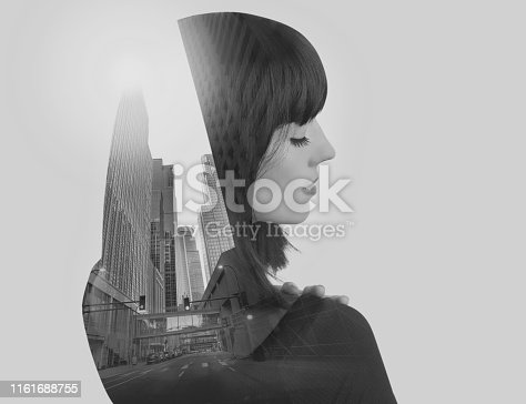 Multiple exposure of a Businesswoman and cityscape