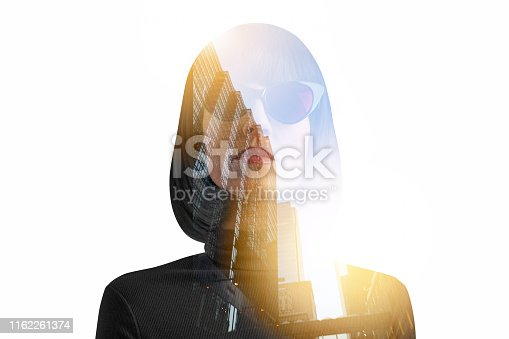 Multiple exposure of a stern woman and cityscape