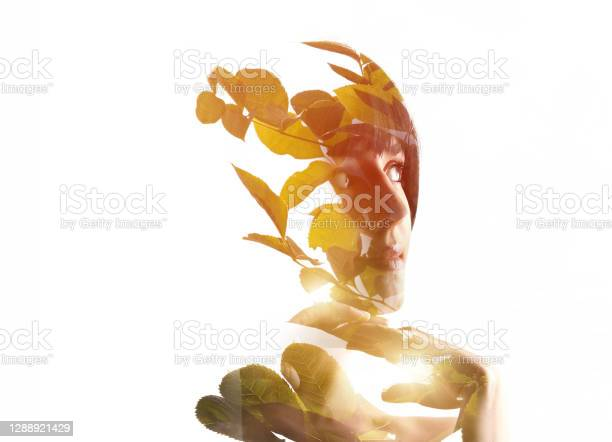 Photo of Multiple exposure of a young woman and nature