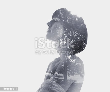 Multiple exposure of a young woman and public park