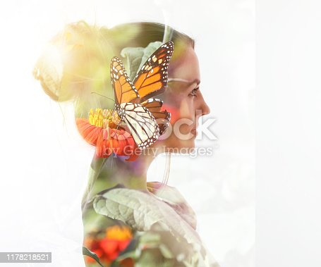 Multiple exposure of a young woman, Monarch Butterfly and flowers