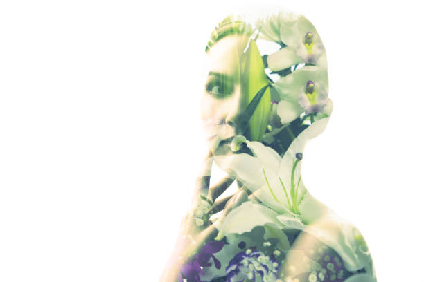 Multiple exposure of beautiful woman and flowers. stock photo