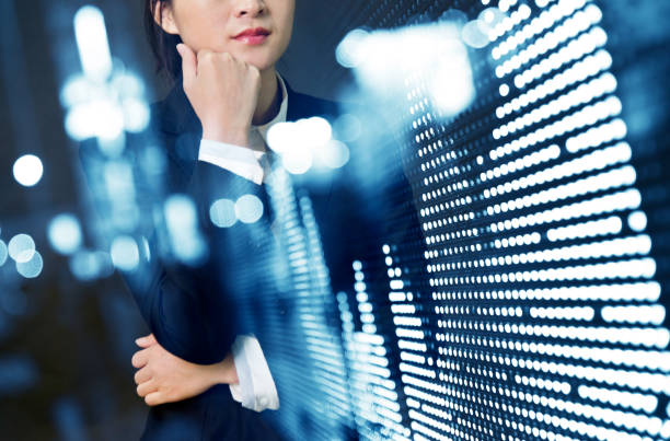 multiple exposure of businesswoman analyzing stock market data - toned image stock photos and pictures