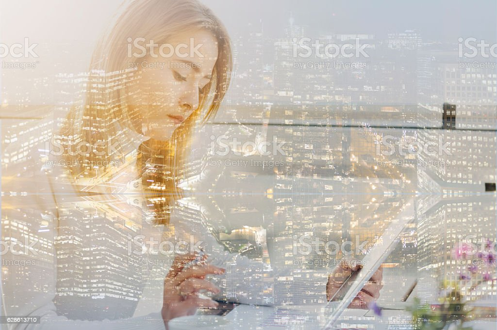 Multiple exposure of city and financial woman stock photo