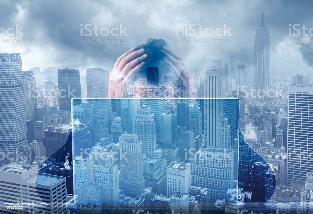 Multiple Exposure Of Frustrated Businessman Working On Laptop Computer stock photo