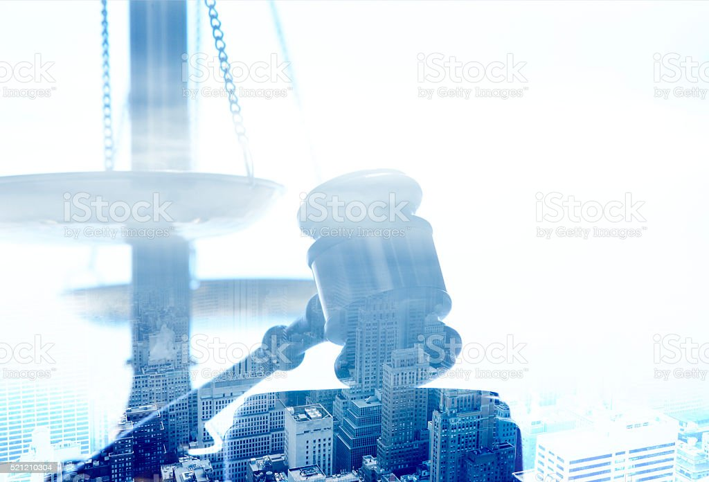 Multiple Exposure Of Gavel And Justice Scale And Urban Scene stock photo