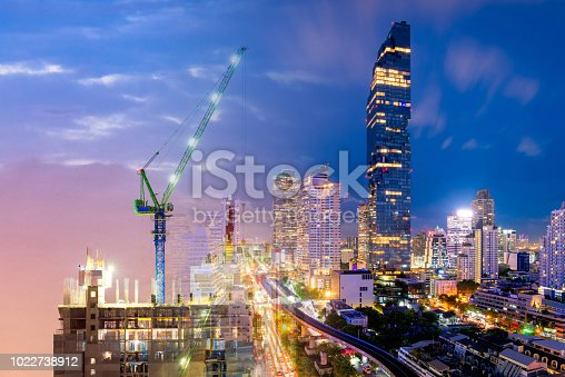 Multiple Exposure of Heavy duty industrial crane and modern building for industry business and construction concept.