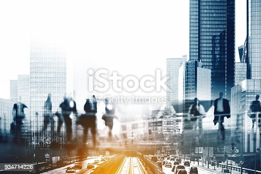 istock Multiple exposure of Silhouettes of people walking in the street near skyscrapers and modern office buildings in Paris business district. Multiple exposure blurred image. Economy, finances, business concept illustration 934714226