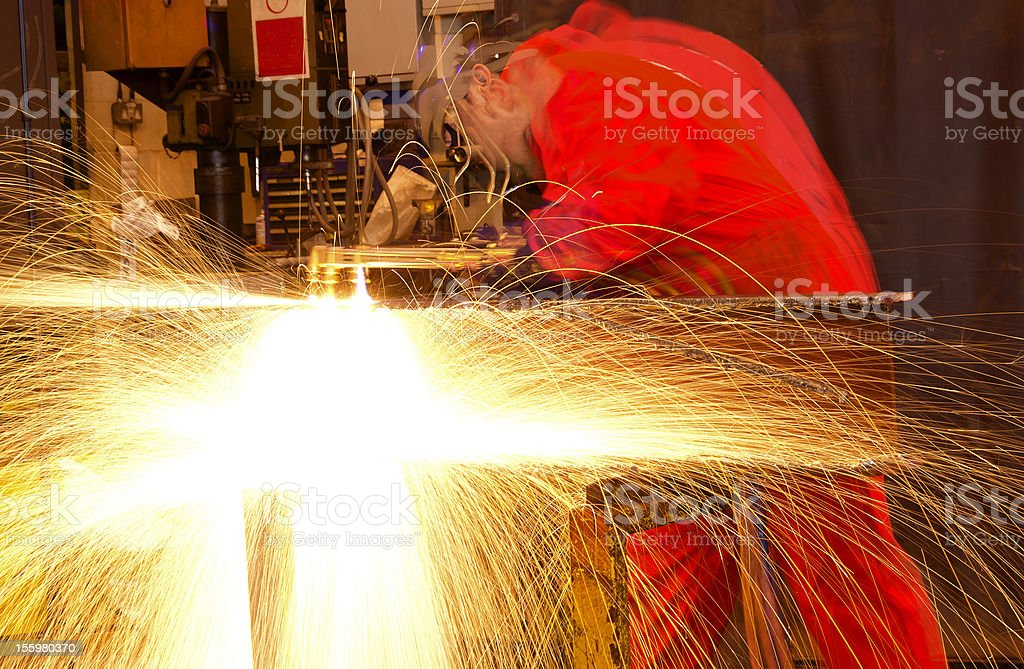 Multiple exposure of welder cutting metal with sparks royalty-free stock photo