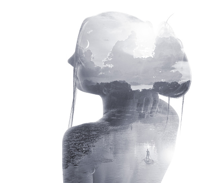 Multiple Exposure of young woman morphing into lake and paddleboarder. Lake of the Isles, Minneapolis.