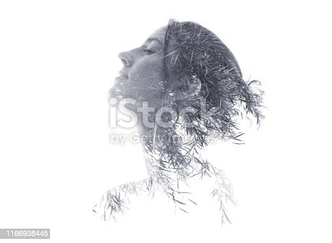 Multiple Exposure of woman morphing into ornamental grass