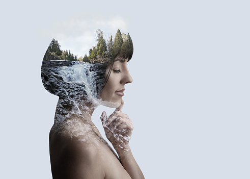 Multiple Exposure of young woman and nature