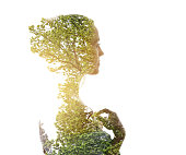 Multiple Exposure of young woman morphing into trees