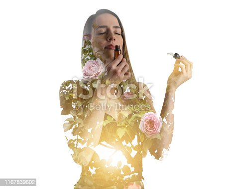 Multiple Exposure of young woman smelling essential oils and rose bush