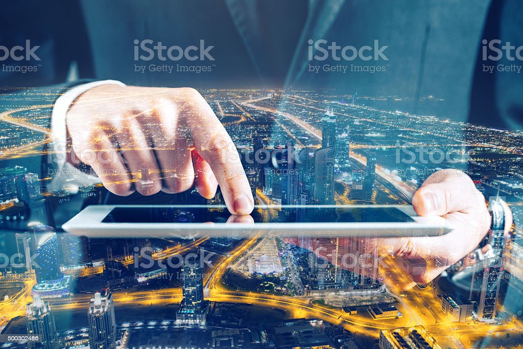 Multiple exposure with business and night cityscape stock photo