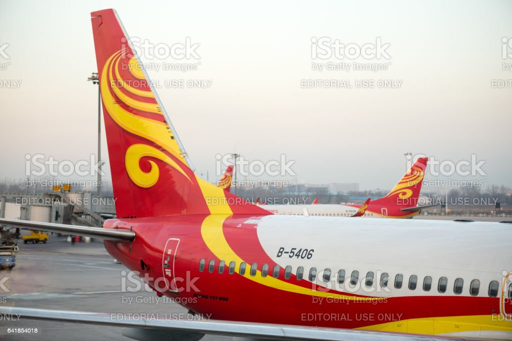 Multiple fins of Hainan Airlines aircraft stock photo