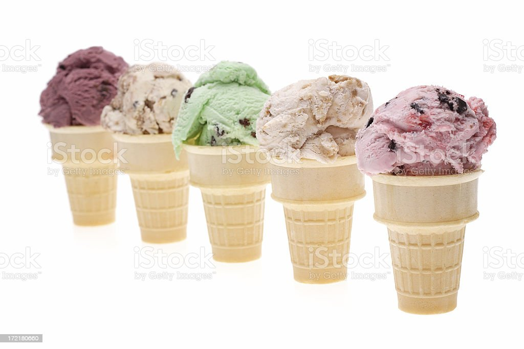 Multiple Flavors of Ice Cream Cones on White Background royalty-free stock photo