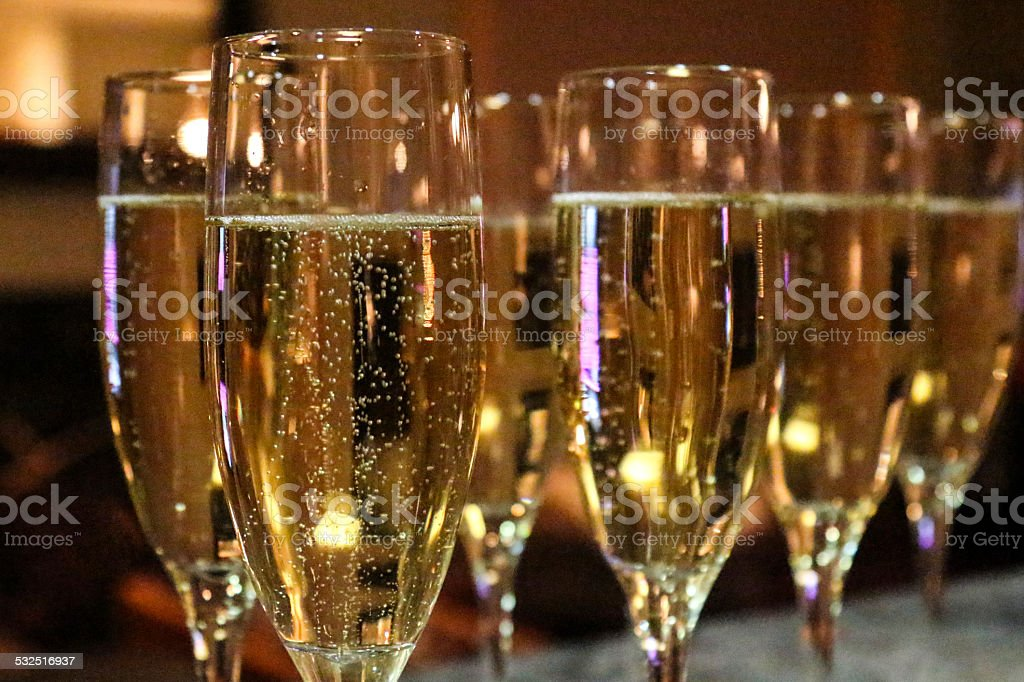 Multiple Flutes of Champagne at an evening party stock photo