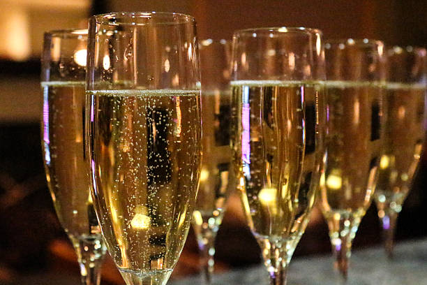 Multiple Flutes of Champagne at an evening party