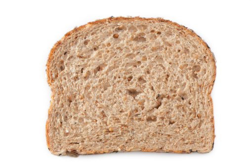 A slice of multiple grain bread on a 255 white background with a clipping path.