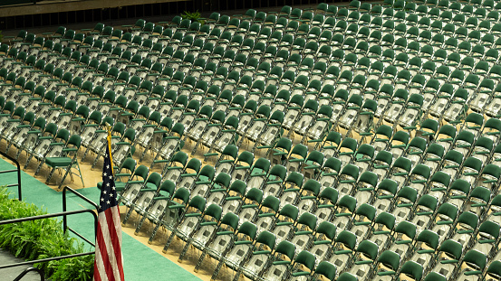 Multiple Green Chairs Arranged In Front Of Stage With American Flag Stock Photo - Download Image Now